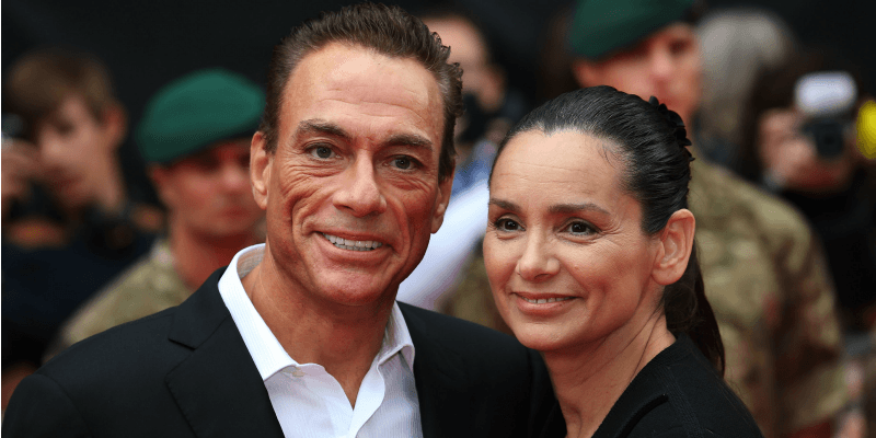 Jean-Claude Van Damme and Gladys Portugues pose together on the red carpet.