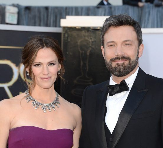 Jennifer Garner and Ben Affleck are dressed elegantly and pose for pictures at The Oscars.