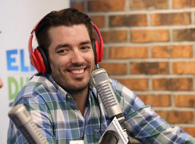 Jonathan Scott wearing a red pair of headphones and speaking into a microphone