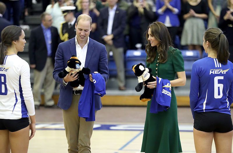 https://www.cheatsheet.com/wp-content/uploads/2017/08/Kate-Middleton-and-Prince-William-accept-gifts-at-a-basketball-game.jpg