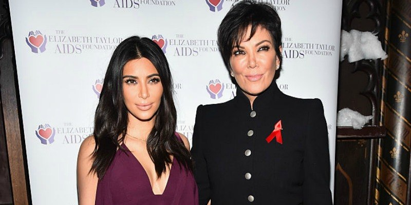 Kim Kardashian and Kris Jenner pose together on the red carpet.