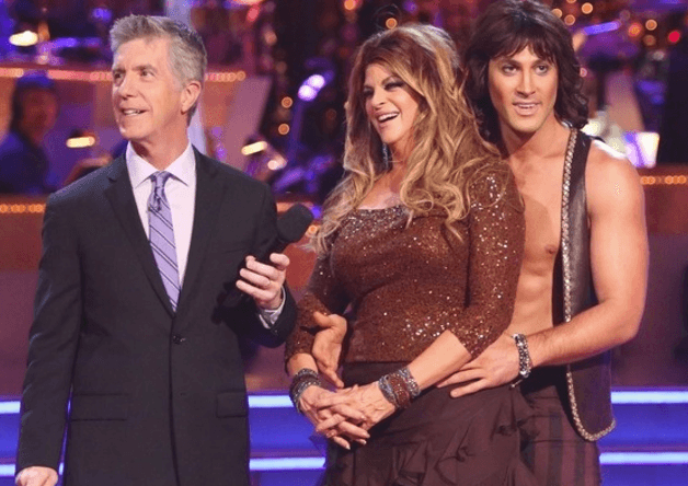 Maksim Chmerkovskiy and Kirstie Alley stand together while hearing their scores.