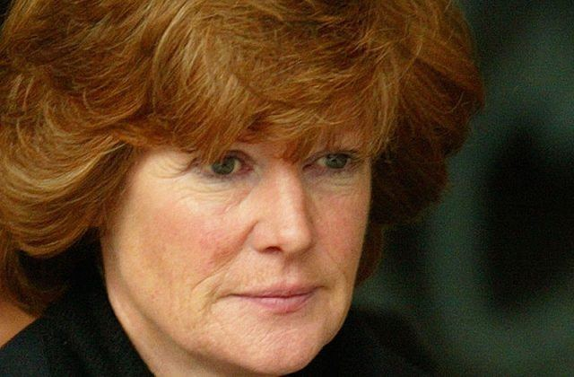 Lady Sarah McCorquodale wearing black clothes and looking straight ahead.