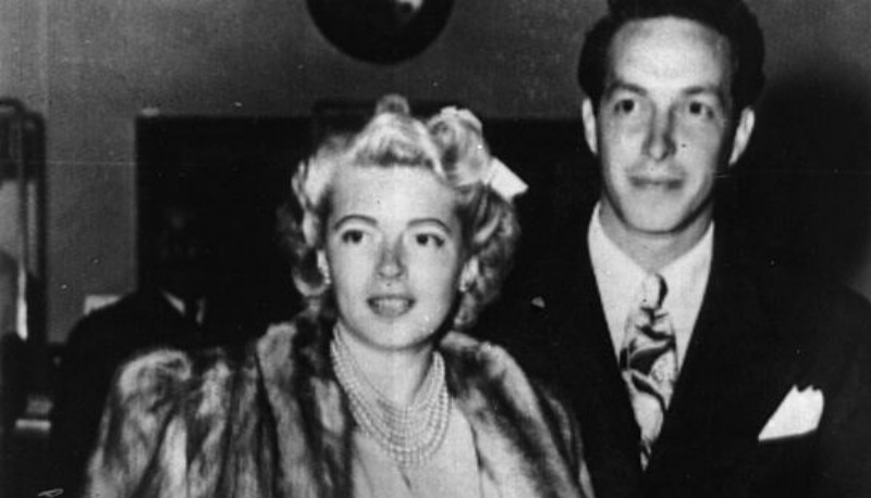 A black and white photo of Lana Turner and Steve Crane posing together