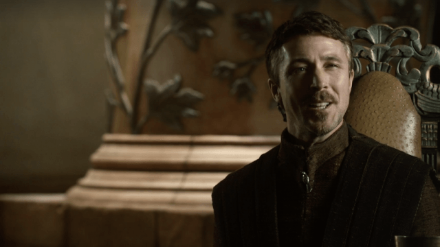 Littlefinger sitting down and speaking.
