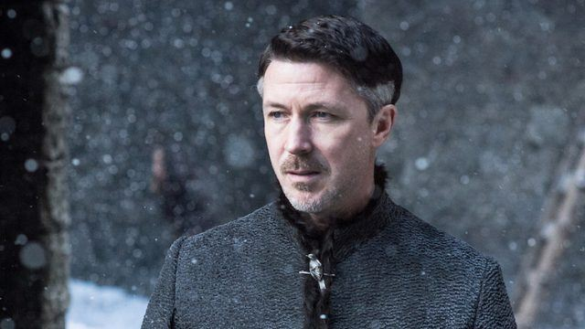 Littlefinger stands in the snow.