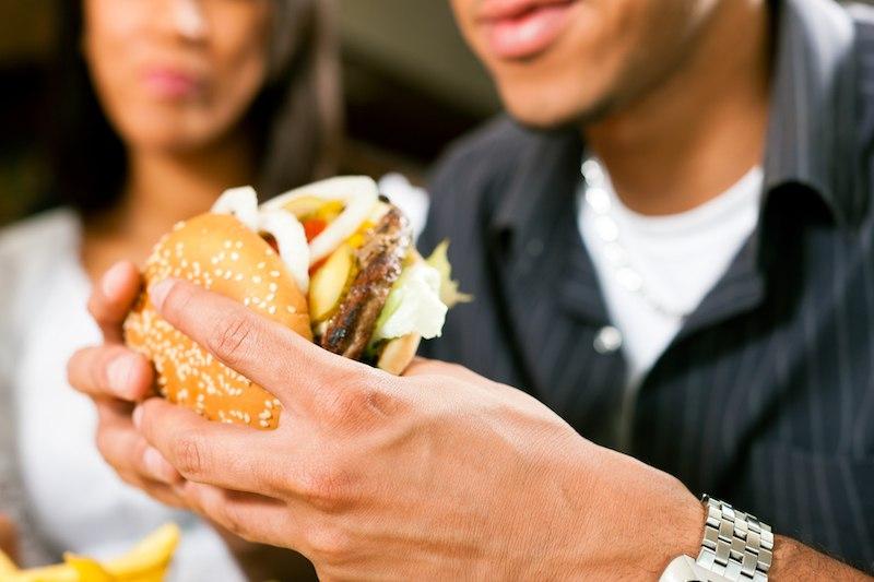 man eating a hamburger