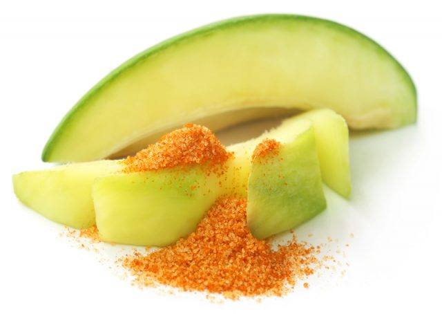 Sliced mango with chili powder.
