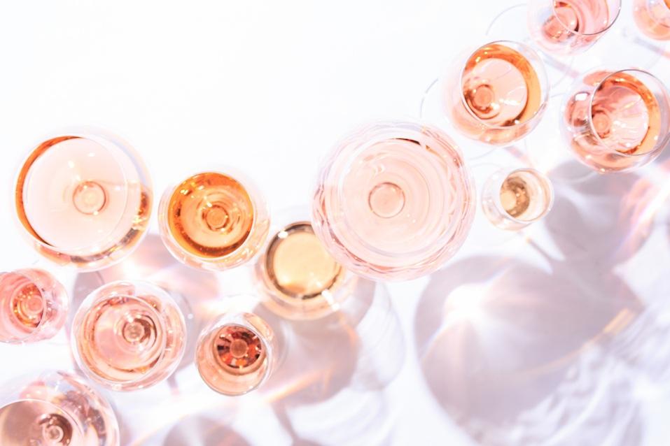 Many glasses of rose wine at wine tasting