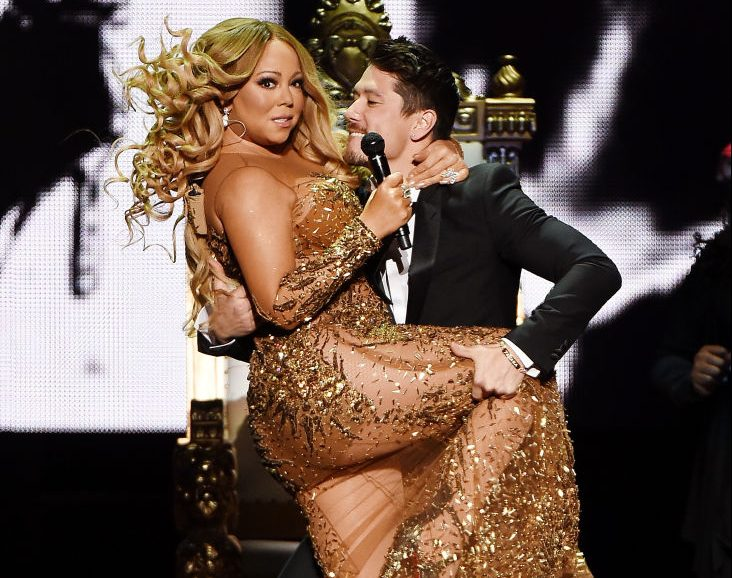 Mariah Carey and Bryan Tanaka perform