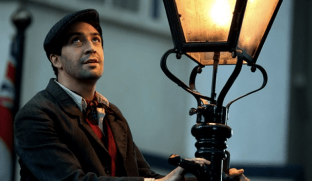 Lin-Manuel Miranda's Jack holds a lantern and looks up at the sky in Mary Poppins Returns