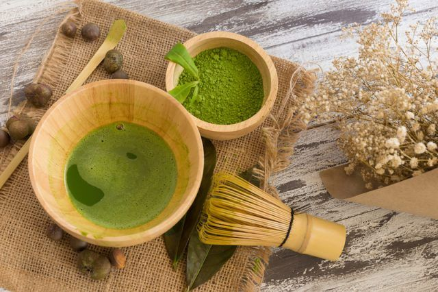 Set of matcha powder bowl, wooden spoon and whisk, green tea leaf, Organic Green Matcha Tea ceremony.