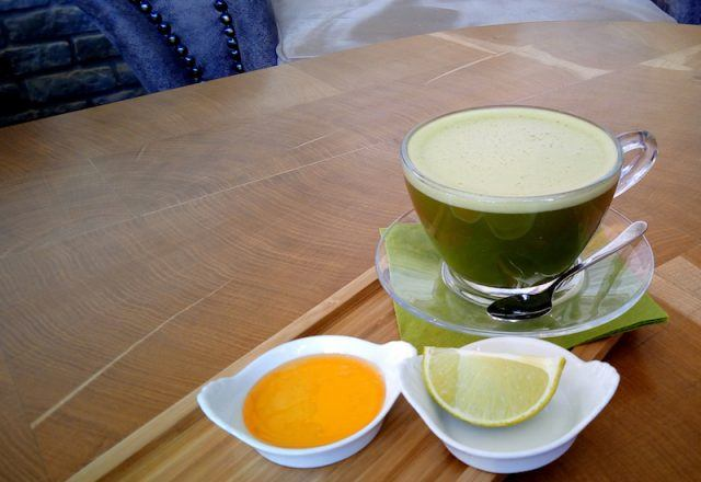 Matcha and lemon laid out on a table.