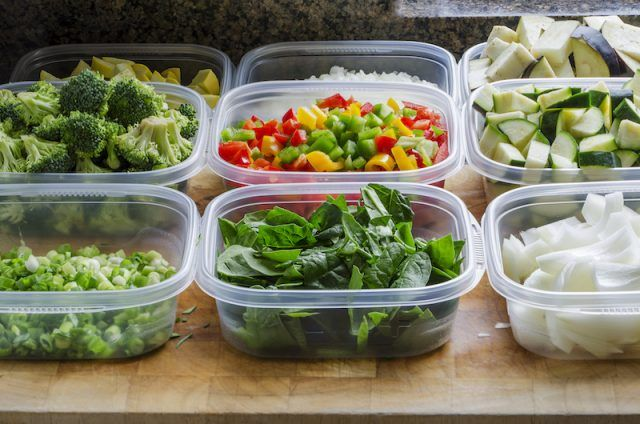 Vegetables cut and placed into containers.