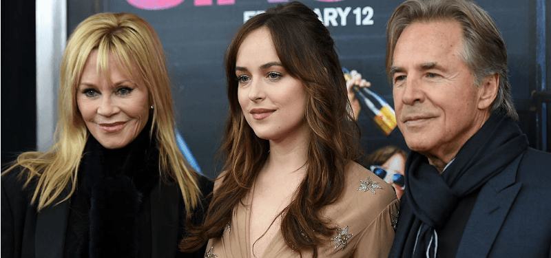 Melanie Griffith, Dakota Johnson, and Don Johnson pose together on the red carpet.