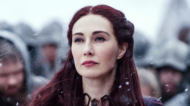 Melisandre stands and stares ahead in the snow.