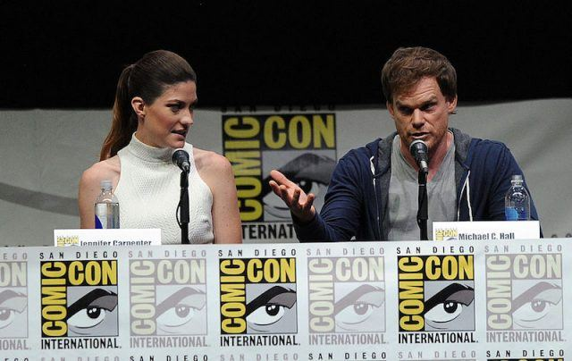 Jennifer Carpenter (L) and Michael C. Hall sit in front of microphones at San Diego Comic-Con.