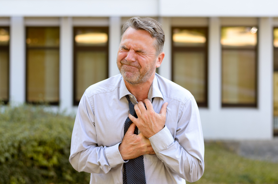 Middle-aged businessman suffering chest pains
