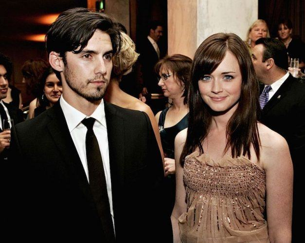 Milo Ventimiglia and Alexis Bledel stand next to each other at a formal event.