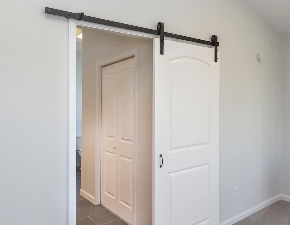 Modern white sliding barn door