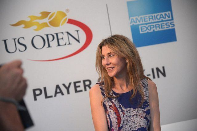 Monica Seles poses for photos and looks over her shoulder.
