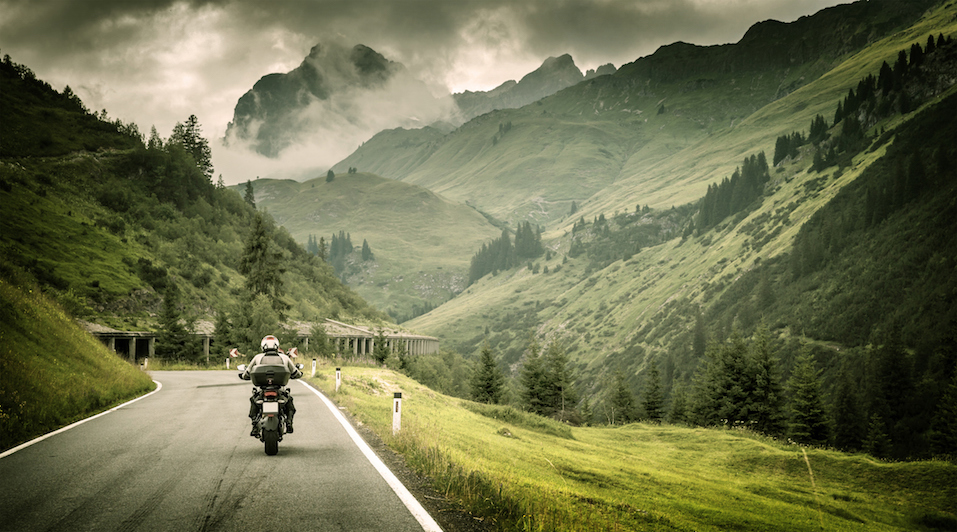 Motorcyclist on mountainous highway