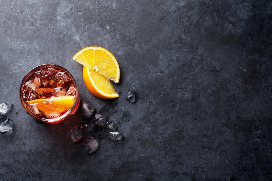 Negroni cocktail on dark stone table