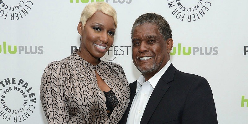 Nene and Gregg Leakes pose together on the red carpet.
