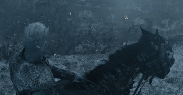 Night King overlooking battle on cliff.