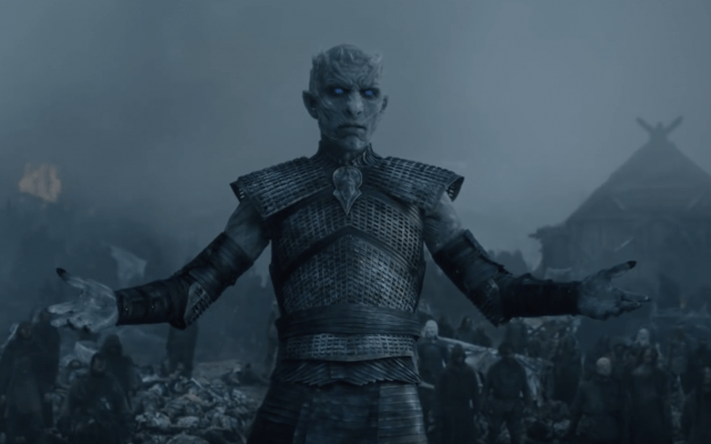 The Night King holds out his hands while staring ahead