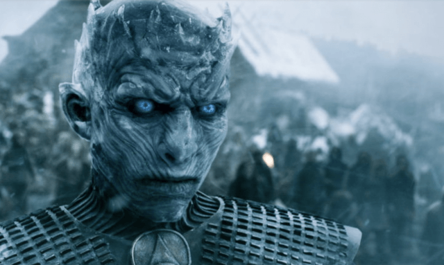 The Night King stands with icy blue eyes.