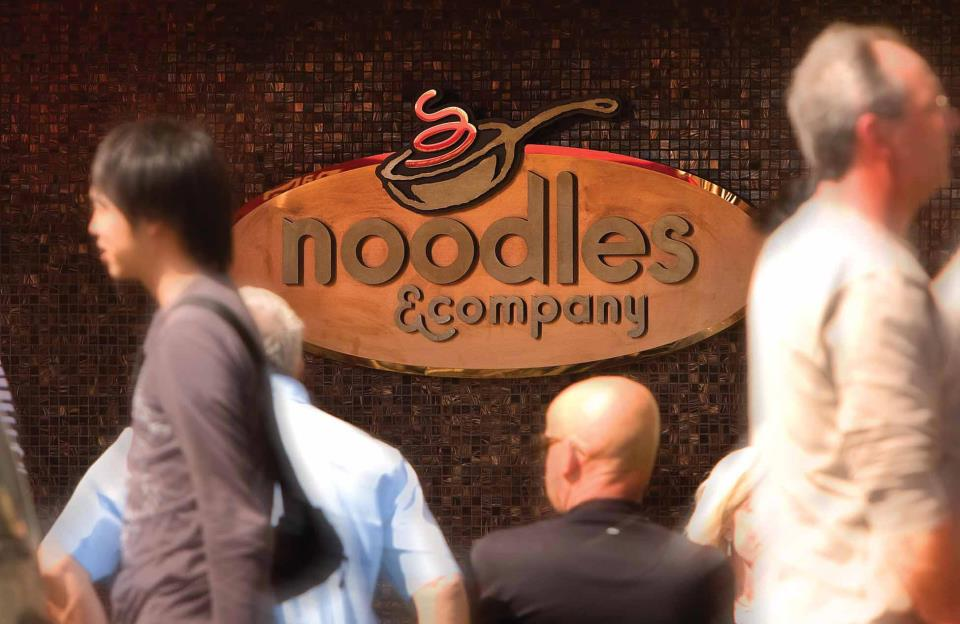 Customers dine at Noodles & Company.