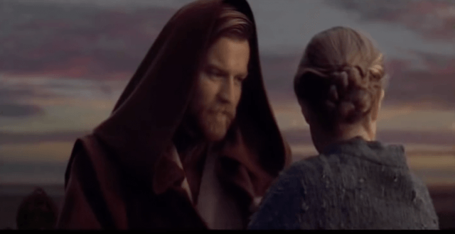 Obi-Wan Kenobi stands in front of a woman in the final scene of 'Star Wars: Revenge of the Sith'.