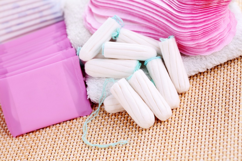 a pile of feminine products in pink