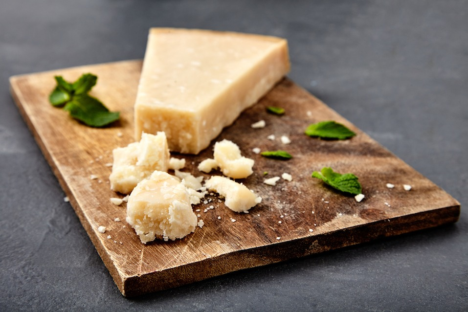 Piece of a parmesan and grated cheese