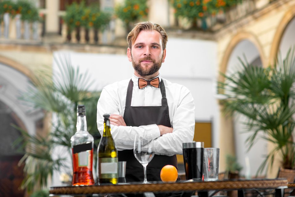 Portrait of handsome barman in uniform