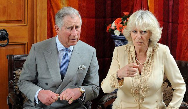 Prince Charles and his wife Camilla Parker Bowles sit together in an office.