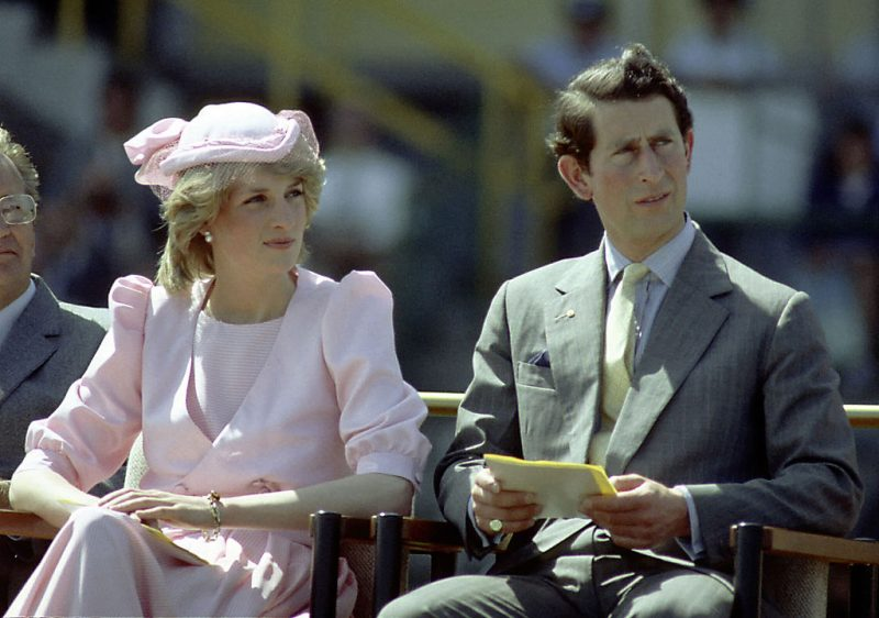 Princess Diana And Prince Charles watch an official event.