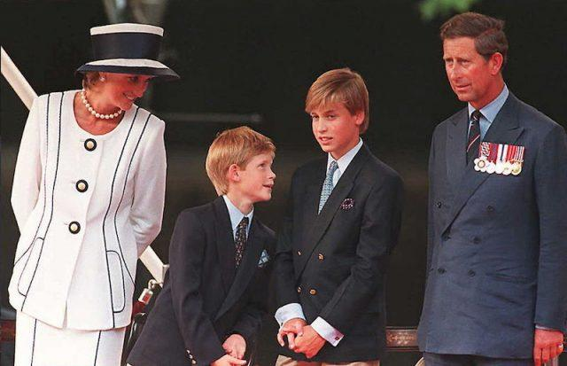 Princess Diana, Prince Harry, Prince William, and Prince Charles standing together.