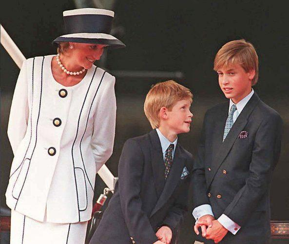 Princess Diana, Prince Harry, and Prince William stand closely together at an event.