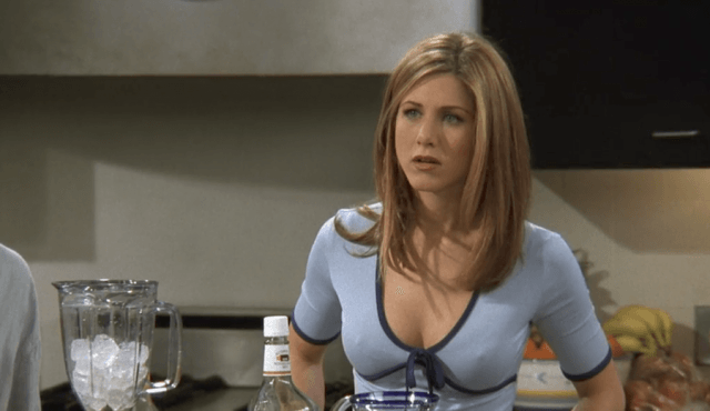 Rachel stands in front of a counter with a blender in Friends