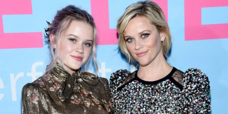 Reese Witherspoon and Ava Elizabeth Phillippe pose together in dresses on the red carpet.