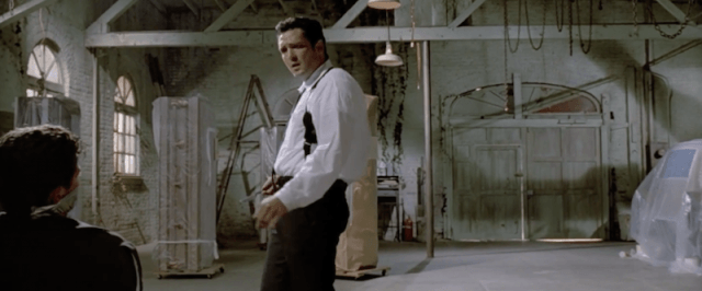A man stands in an torture chamber in Reservoir Dogs