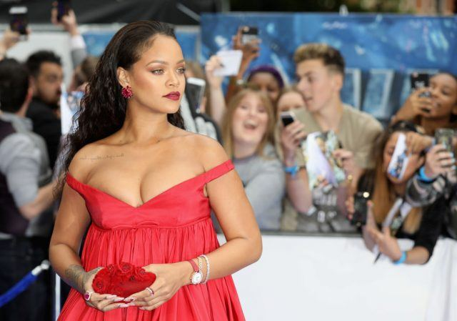 Rihanna looking stunning in a curve-hugging red gown.
