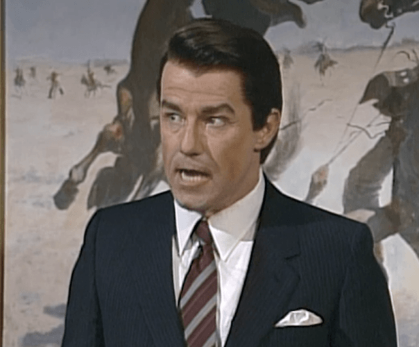 Phil Hartman's Ronald Reagan stands in front of a painting in his office.