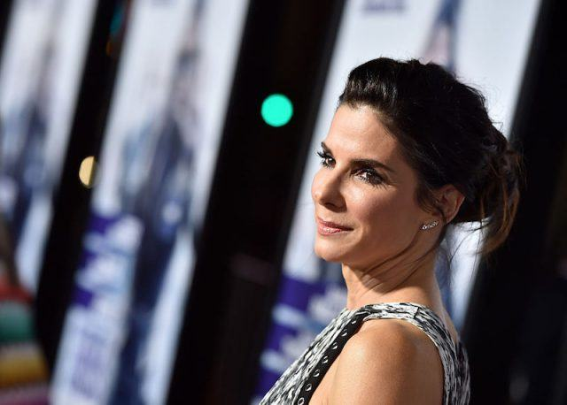 Sandra Bullock poses for photos at the premiere of 'Our Brand Is Crisis'.