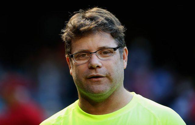 Sean Astin stands at a Dodger's game.