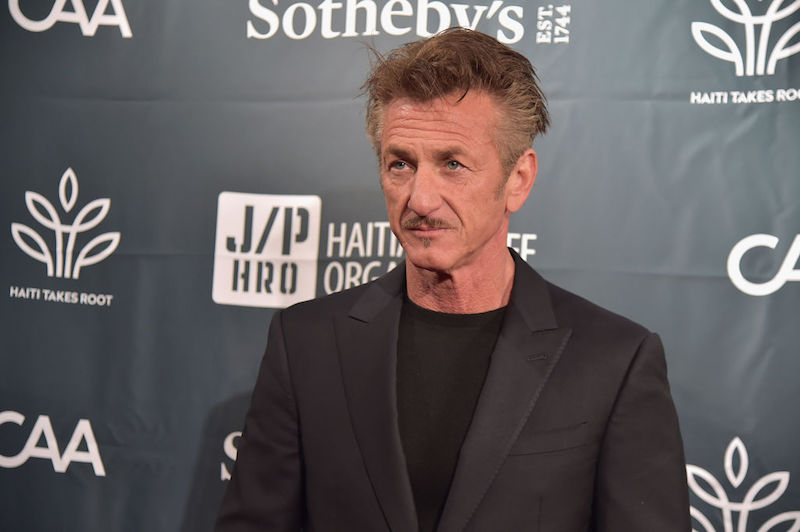 Sean Penn poses for photos at a benefit dinner for 'Rebuild Haiti'.