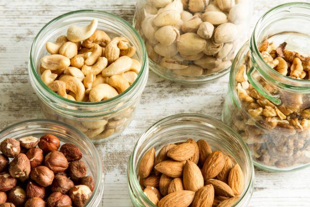 Nuts and almonds spread out on a table.