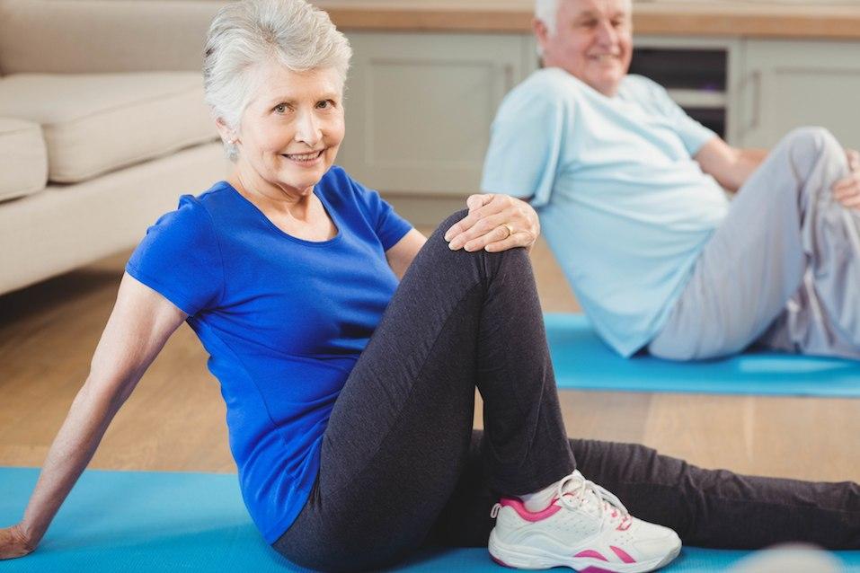 Senior couple performing yoga exercise